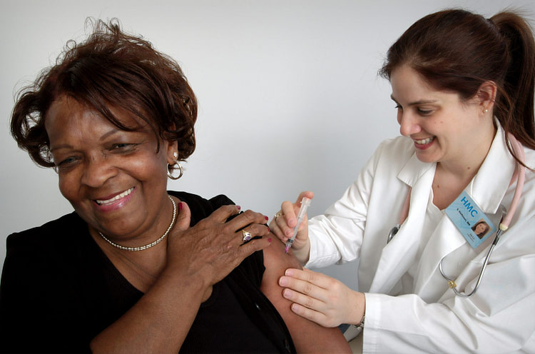 woman getting vaccine