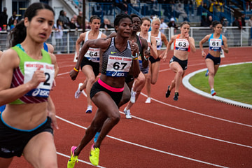 woman running competition