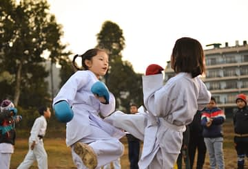children participating in martial art sparring