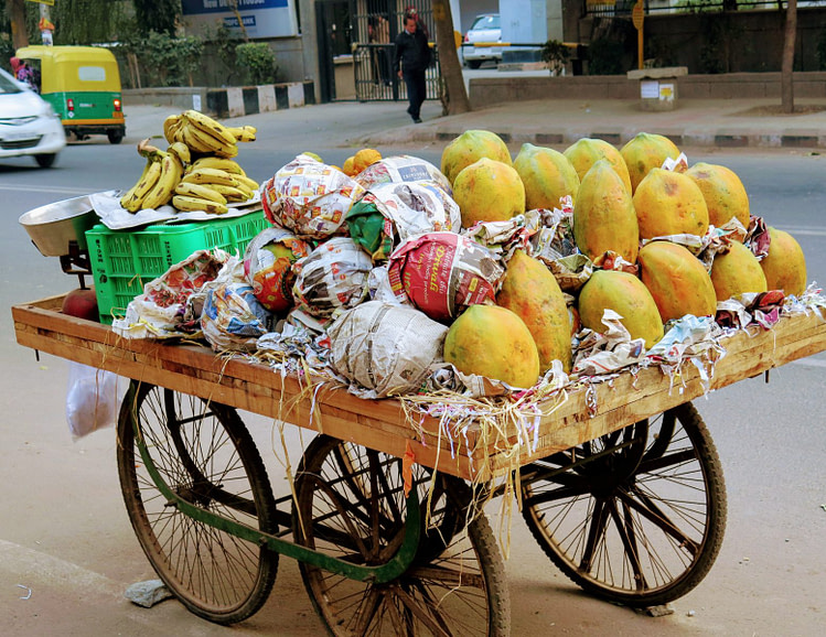 assorted fruits on fruit rack